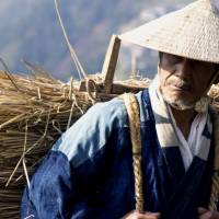 Working the land: Min Tanaka plays an old man living in the thick of nature in 'Iya Monogatari: Oku no Hito (The Tale of Iya).' But his experience is different than that of his young adopted charge, and a man who moves to Shikoku's Iya Valley to escape city life.