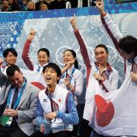 All for one, one for all: The Japanese team celebrates with Yuzuru Hanyu (front, center) after his short program during the men's portion of the Olympic team figure skating competition.   | AP