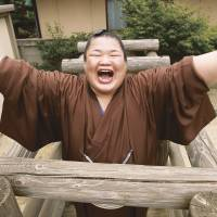Happy go lucky: Sumo wrestler Fujiazuma celebrates after winning promotion in June 2011. | KYODO