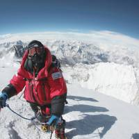 Sky high: Alpinist Yuichiro Miura poses for a photo on the summit of Mount Everest on May 23, 2013. | PHOTO COURTESY OF MIURA DOLPHINS