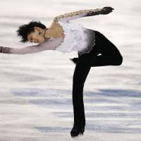 Yuzuru Hanyu of Japan competes in the men's free skate figure skating final at the Iceberg Skating Palace. | AP