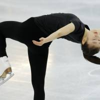 South Korea's Kim Yu-na skates in the practice rink Friday evening at the 2014 Winter Olympics.