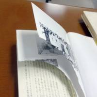 A defaced copy of the 'Diary of a Young Girl' by Anne Frank is seen Friday at a public library in Tokyo's Suginami Ward. | KYODO