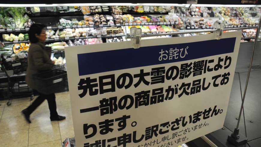 A supermarket in Tokyo displays a sign telling shoppers some food products are in short supply because of the recent heavy snowfall.