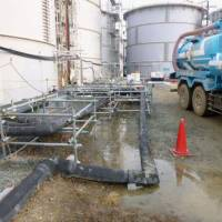 Highly radioactive water that spilled from a storage tank at the Fukushima No. 1 nuclear power plant is seen in this handout photo. | TEPCO/KYODO