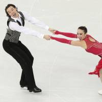 Siblings Cathy and Chris Reed of Japan compete in the ice dance short dance figure skating competition at the Iceberg Skating Palace during the 2014 Winter Olympics Feb. 16 in Sochi, Russia. | AP