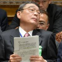 Feet to the fire: New NHK chief Katsuto Momii is grilled in the Lower House on Friday. | AFP-JIJI