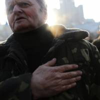 Putin faces double-edged sword in responding to Ukrainian turmoil