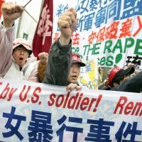 Stoking anger: Protesters shout slogans during a March 2008 rally against an alleged rape of a 14-year-old girl by an American serviceman in Okinawa Prefecture. | AP