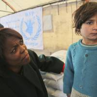 Food crunch: U.N. World Food Program Chief Executive Ertharin Cousin meets a girl from a displaced family in Damascus on Jan. 9 in this photo supplied by the United Nations. | AP