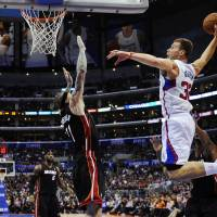 Flight control: Los Angeles' Blake Griffin goes up for a dunk as Miami's Chris Andersen defends during the Heat's 116-112 win on Wednesday. | AP