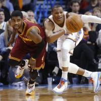 Hot pursuit: Cleveland's Kyrie Irving (left) competes with Oklahoma City's Russell Westbrook during Wednesday's game. | AP