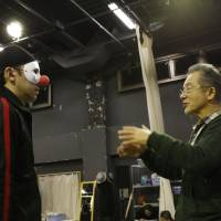 He nose, you know: Kamezou Kataoka (left) is schooled for his part in 'Cry Some More For Me, Flapper' by the 1977 play's writer and current director, Kazuyoshi Kushida. | AKIO