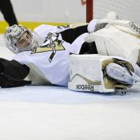 By any means necessary: Pittsburgh goalie Marc-Andre Fleury makes a save during the Penguins' 5-1 win over the Sabres on Wednesday. | AP