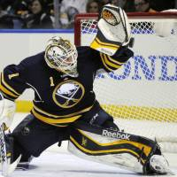 Got it covered: Buffalo goalie Jhonas Enroth makes a save during the Sabres' 5-4 win over the Bruins on Wednesday. | AP