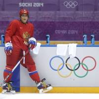Ovechkin touches down in Russia