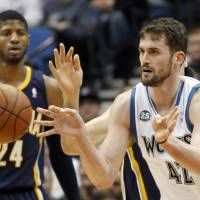 Love is all you need: Minnesota's Kevin Love passes the ball as Indiana's Paul George looks on during the Timberwolves' 104-91 win over the Pacers on Wednesday. | AP