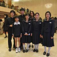 Starting young: Seven students who are studying composition with Fukushima University's Takehito Shimazu, who also teaches at the institution's attached junior high school, attend the New York Philharmonic's special concert on Feb. 11 at Tokyo's Suntory Hall. | RIKIMARU HOTTA