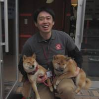 Puppy love: Chikao Muratani, owner and veterinarian at Anima Animal Hospital, is inspired by the innocence of his furry charges, such as these Shiba dogs. | JUDIT KAWAGUCHI