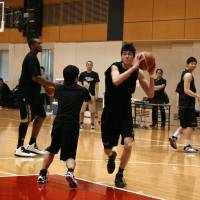 American dream: Yuta Watanabe, pictured during practice with the Japan national team last year, has decided to attend George Washington University next season. | KAZ NAGATSUKA