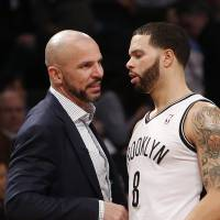 Meeting of the minds: Nets head coach Jason Kidd (left) and point guard Deron Williams speak during Thursday's game. | AP