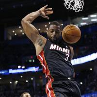 Clear skies ahead: Heat guard Dwyane Wade dunks against the Thunder on Thursday. Miami beat Oklahoma City 103-81. | AP