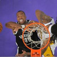 Business as usual: Nets center Jason Collins (left) competes against the Lakers' Jordan Hill on Sunday. | AP