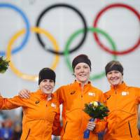 Oranje crush: (From left) Silver medalist Ireen Wust, gold medalist Jorien ter Mors and bronze medalist Lotte van Beek celebrate after the women's 1,500-meter race. | AP