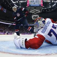 Me vs. you: U.S. forward T.J. Oshie scores past Russia's Sergei Bobrovsky during the shootout on Saturday. | AP