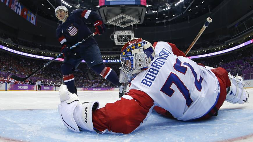 Me vs. you: U.S. forward T.J. Oshie scores past Russia's Sergei Bobrovsky during the shootout on Saturday.