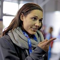 In the spotlight: Lolo Jones gestures during an interview after arriving in Sochi, Russia, on Jan. 30. | AP