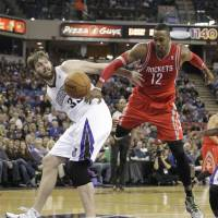 Rocket fuel: Houston's Dwight Howard (right) competes for a rebound with Sacramento's Aaron Gray during the Rockets' 129-103 win on Tuesday. | AP