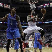 Wall eclipses Durant; Wizards end Thunder's 10-game streak