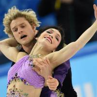 Shared moment: Charlie White and Meryl Davis perform their free dance at the Iceberg Skating Palace on Monday. | AFP-JIJI