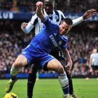 Upwardly mobile: Chelsea's Cesar Azpilicueta shields the ball from Newcastle's Mapou Yanga-Mbiwa on Saturday. | AFP-JIJI