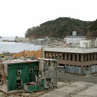 The branch of 77 Bank (building on the right) in Onagawa, Miyagi Prefecture, is just a ruin in  April 2012. | KYODO