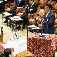 Prime Minister Shinzo Abe answers questions during Thursday's session of the Lower House Budget Committee. | KYODO