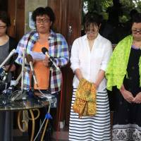 Rescued Japanese divers (from right) Nahomi Tomita, Atsumi Yoshidome, Emi Yamamoto and Aya Morizono talk to media at a hospital in Bali, Indonesia, after they were discharged Thursday. | AP