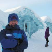 Hidenobu Nakaya, who designed Japan's first hotel made of ice, poses in front of the Ice Hills Hotel in Tobetsu, Hokkaido. | KYODO