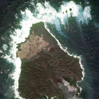 A new volcanic islet in the Pacific Ocean is shown after merging with Nishinoshima Island, part of the Ogasawara chain, in this image taken by the Geospatial Information Authority of Japan on Feb. 16. | KYODO