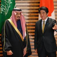 Saudi Arabian Crown Prince Salman bin Abdul-Aziz is greeted by Prime Minister Shinzo Abe for their talks in Tokyo on Wednesday. | AFP-JIJI