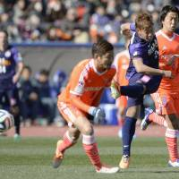 On target: Hiroshima Sanfrecce's Gakuto Notsuda follows through on a shot against Yokohama F. Marinos on Saturday. | KYODO