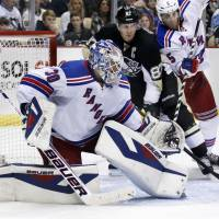 Immovable object: Rangers goalie Henrik Lundqvist blocks a shot during New York's 4-3 shootout win over the Penguins on Friday. | AP