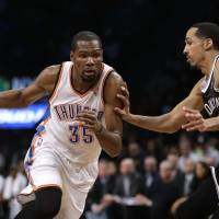 Unstoppable: Thunder forward Kevin Durant drives against the Nets' Shaun Livingston on Friday. | AP