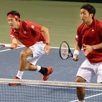 Twice as nice: Kei Nishikori (left) and Yasutaka Uchiyama compete in Davis Cup doubles on Saturday. | AFP-JIJI