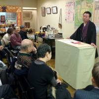 Getting the word out: Professional storyteller Kyokudo Nankai addresses a gathering in a Buddhist temple in Chuo Ward, Osaka, on Dec. 27. | KYODO