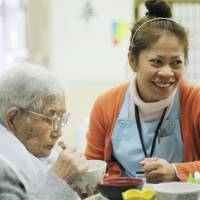 Elderly perked up by Filipino caregiver