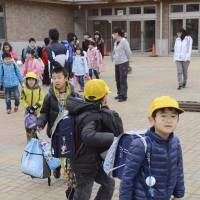 School's out: Students at Kawauchi Elementary School in the Fukushima Prefecture village get ready to go home for the day on Jan. 24. | KYODO
