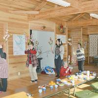 Local residents practice dance steps in a room in the Berlin Haus in January. | KYODO