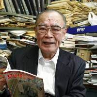 Rolling them out: Haruo Ishibashi, editor-in-chief of Tetsudo Mokei Shumi, holds the 800th edition of the monthly magazine at the Tokyo office of his publishing firm Jan. 16. | KYODO